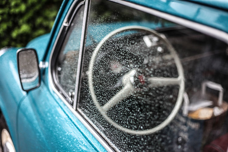 blue vintage car interior in rainy day Blue Car Car Car Interior Close-up Day Detail Glass - Material Mode Of Transport Old Car Part Of Reflection Shiny Side-view Mirror Transportation Travel Vehicle Interior Vehicle Part Vintage Cars The Drive. The Drive