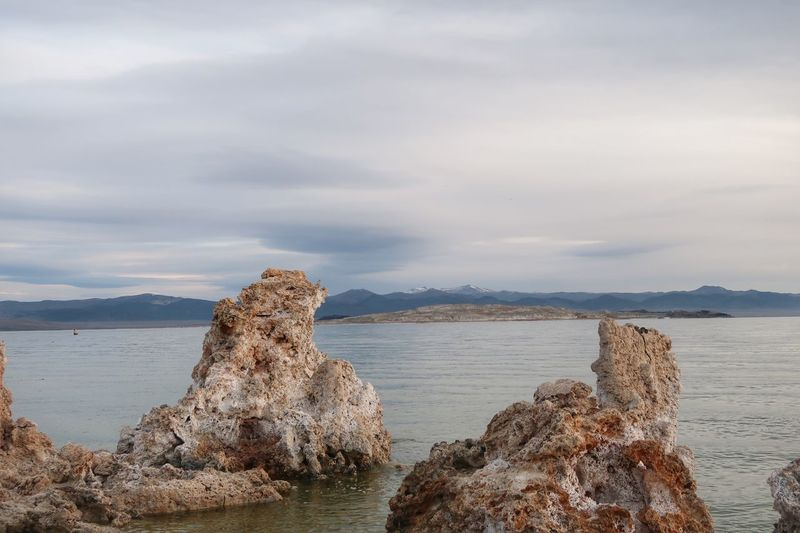 Landscape of Mono Lake and large tufa up close Tufa Mono Lake EyeEm Selects Water Sea Sky Cloud - Sky Tranquility Beach Land Beauty In Nature Tranquil Scene Rock Nature Rock - Object Solid No People Day Non-urban Scene Outdoors Mountain Scenics - Nature