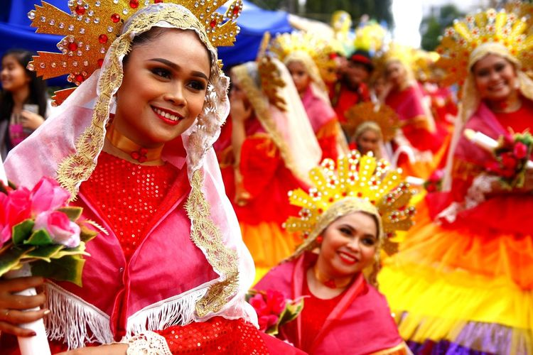 parade participants of the Sumakah Festival in Antipolo City, Philippines dance in the street in their colorful costumes ASIA Asian  Philippines Filipino Antipolo, Rizal Ph Sumakah Festival Festival Festival Season Fiesta Costume Dance Dancer Street Dance Street Dancers Travel Destinations Travel Beautiful Beautiful Woman Tradition Cultures Celebration Headwear Smiling City Headdress Cheerful Young Women