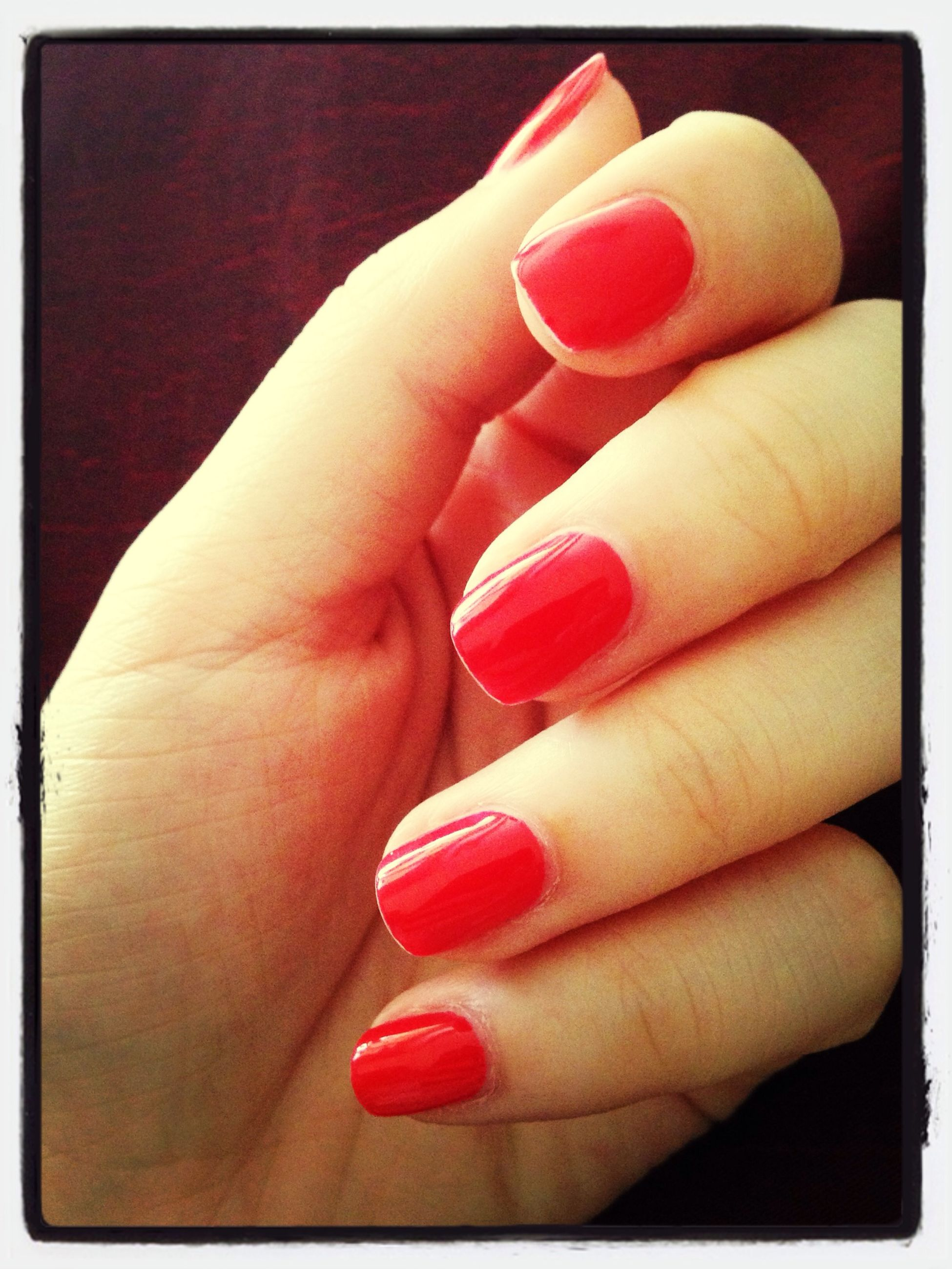 person, part of, holding, human finger, red, cropped, indoors, close-up, transfer print, lifestyles, nail polish, auto post production filter, studio shot, unrecognizable person, food and drink, showing