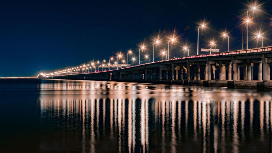 Penang Bridge, The Original Illuminated Night Reflection Bridge Built Structure Bridge - Man Made Structure Connection Water Architecture Transportation Waterfront No People Sky Street Light River Long Exposure City Outdoors