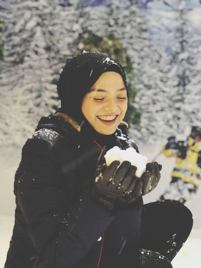 The bunny in the snow. One Person Real People Leisure Activity Lifestyles Smiling Young Adult Cold Temperature Winter Young Women Warm Clothing Snow Happiness Clothing