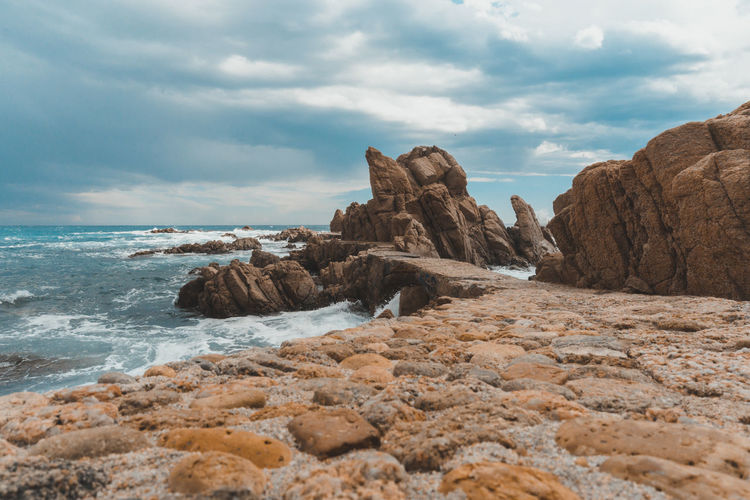 Sky Cloud - Sky Rock Sea Rock - Object Solid Water Scenics - Nature Beauty In Nature Rock Formation Land Beach Nature Tranquil Scene No People Tranquility Day Horizon Motion Horizon Over Water Eroded Ocean Wave Road Landscape Stay Out