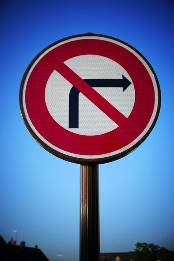 Low Angle View Of No Right Turn Sign