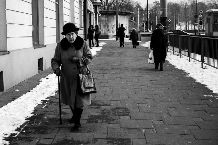 La dame à la canne 35mm Adult Adults Only Architecture Black Blackandwhite City Day Fuji Full Length Lady Men One Person Outdoors People Poland Portrait Real People Responsibility Snow Street Streetphotography Warsaw Winter Woman