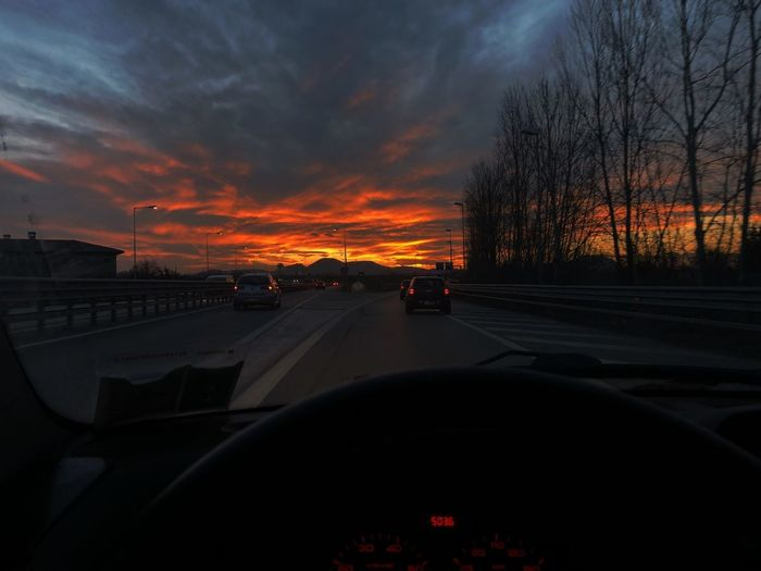 Think about something Car Land Vehicle Transportation Vehicle Interior Sunset Car Interior Mode Of Transport Nature Sky Road Business Stories