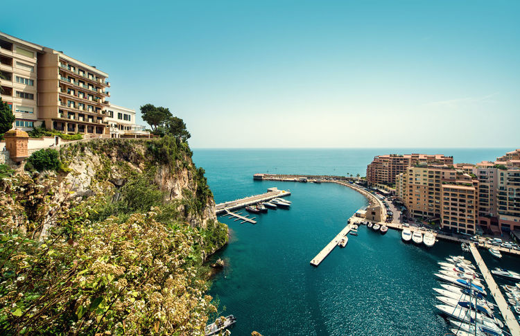 View of Fontvieille. Principality of Monaco City Cityscape Harbor Marina Mediterranean Sea Monaco Architecture Building Exterior Built Structure Fontvieille Landscape Moored Mountain Outdoors Port Principality Of Monaco Scenery Sea Seaside Sunny Day Tourism Travel Destinations Water Yacht Yachting