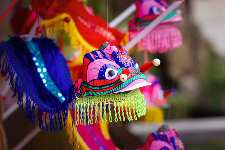 Close-up of colorful toy hanging for sale