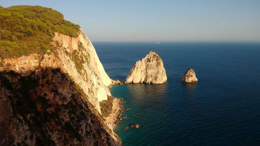 Mountain at zakynthos island by sea against sky