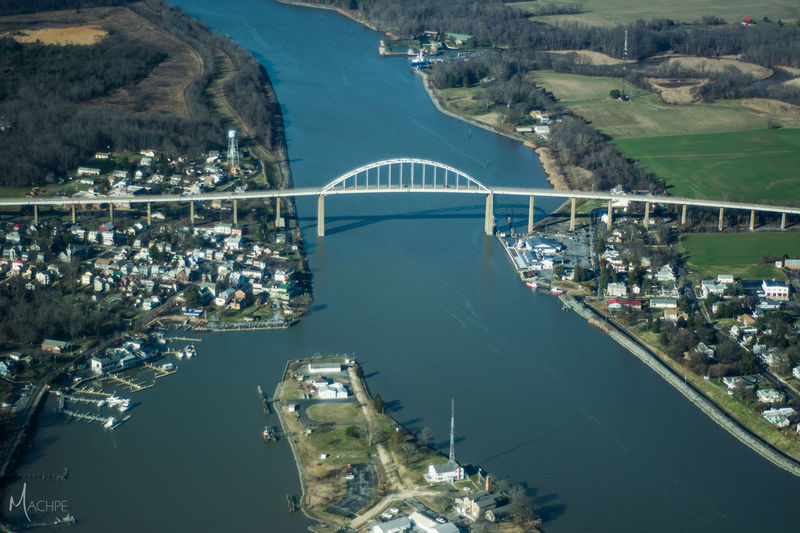 Aerial View Architecture Bridge Bridge - Man Made Structure Building Exterior Built Structure City Community Composition Connection High Angle View Human Settlement Mode Of Transport Nautical Vessel Outdoors Perspective Residential District River Top Perspective Transportation Trip Voyage Water Waterfront