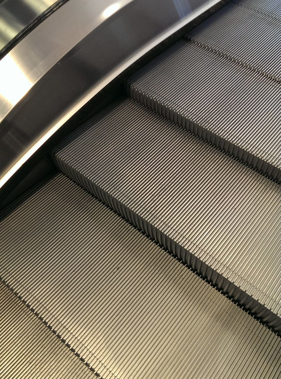 LOW ANGLE VIEW OF ESCALATOR ON CEILING