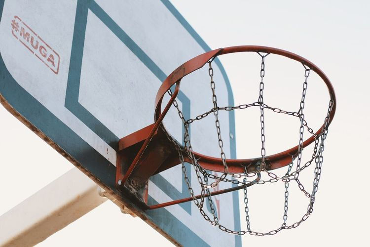 Basketball hoop Basketball - Sport Basketball Hoop Net - Sports Equipment Metal No People Sport Low Angle View Architecture Geometric Shape Outdoors Sky Clear Sky Ball Close-up Rusty Built Structure Shape Day Nature Circle