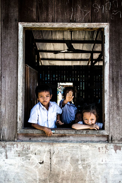 Primary school of Don Det village | Laos. ASIA Primary School Travel Boys Built Structure Child Childhood Day Education Frame Girls Group Of People Happiness Island Looking At Camera People Portrait Real People Smiling Window