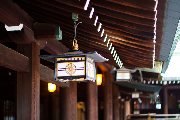 Illuminated lantern hanging at temple