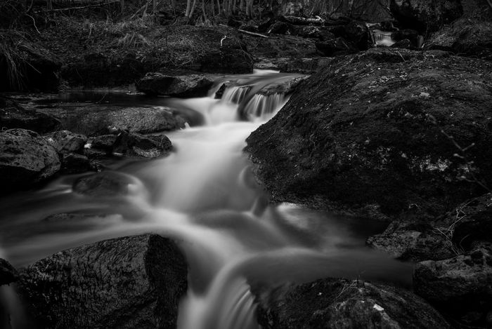 Small stream in Dalarna, Sweden Beauty In Nature Black And White Blackandwhite Blurred Motion Dalarna Dalecarlia Flowing Flowing Water Forest Long Exposure Motion Nature Non-urban Scene Northern Europe Outdoors Purity Rock Rock - Object Rock Formation Scandinavia Stream Sweden Tranquil Scene Water Waterfall