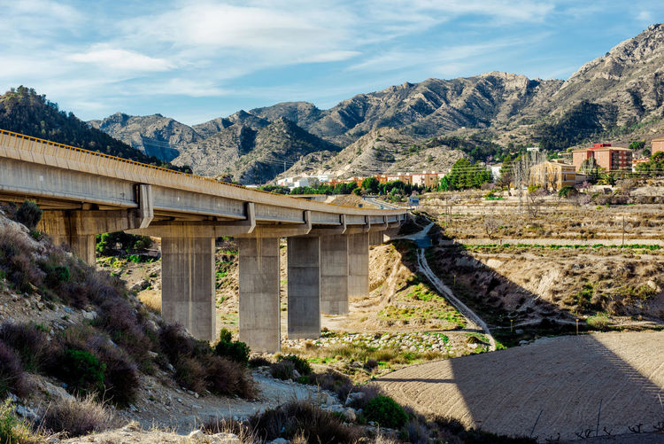 Bridge to the Xixona/Jijona town in Alicante province. Spain Alicante, Spain Architecture Bridge Bridge - Man Made Structure Costa Blanca Day Europe Jijona Landscape Mediterranean  Mountain Mountain Range Nature Nobody Outdoors Rock Formation Rocky Mountains Rural Scene Scenery Sky SPAIN Town Travel Xixona