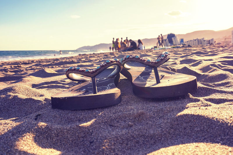 A lovely sunset at the platja Beach Flipflops Horizon Over Water Outdoors Sand Sea Shadow Sky Sommergefühle Summer Sunlight Sunset Water EyeEm Selects
