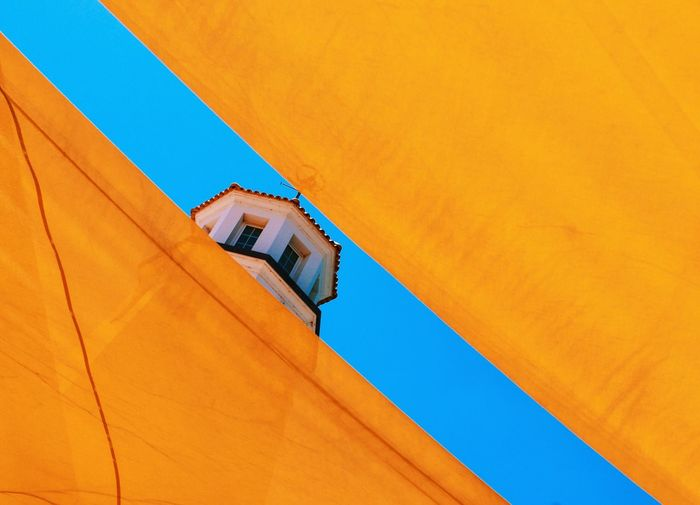 Peek-a-boo. P278 Fine Art Photography Madeira Outdoors Sunny Day High Temperatures Cooling Off Tarp Onephotoaday 365project2016 Shade Architecture Architectural Detail Yellow Diagonal