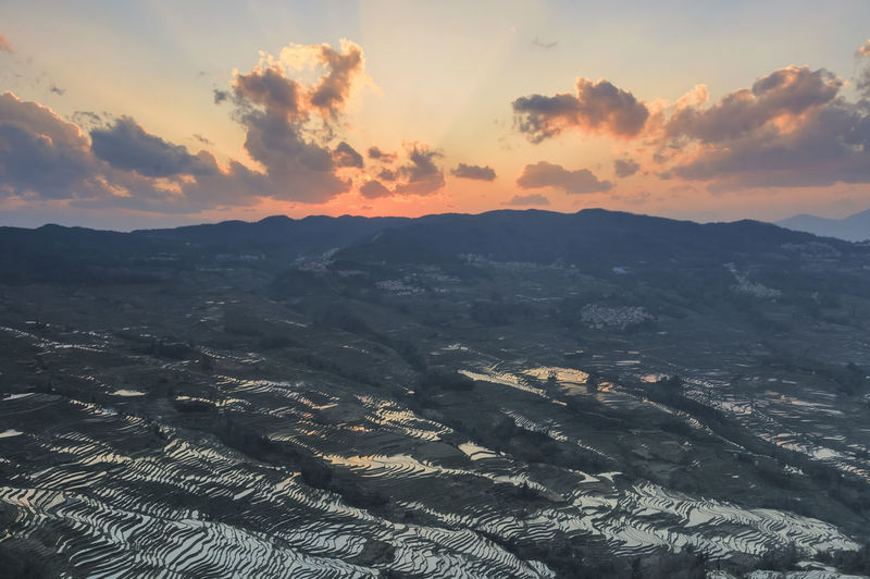Scenic View Of Rice Terraces At Yuanyang County During Sunset