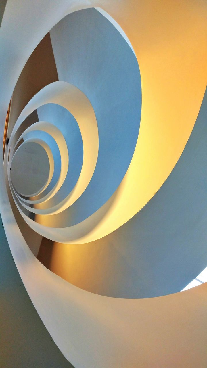 spiral, architecture, curve, steps and staircases, staircase, abstract, no people, built structure, close-up, indoors, day