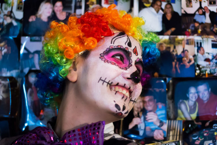 Carnival Celebration Close-up Clown Costume Day Face Paint Focus On Foreground Fun Halloween Headshot Holi Leisure Activity Lifestyles Make-up Mime Multi Colored One Person Outdoors People Real People Young Adult