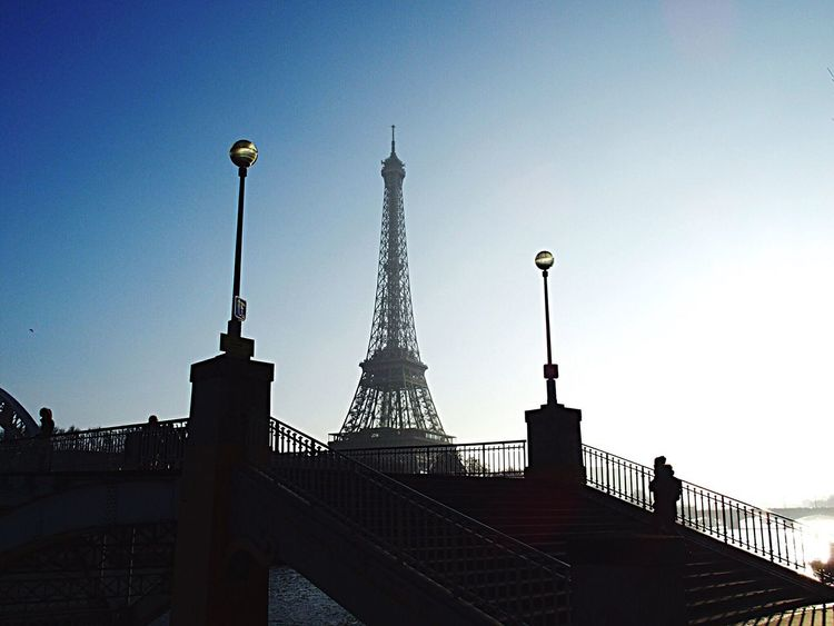 An afternoon in winter. Travel Destinations City Travel Tower Tourism Vacations Cultures Sky Architecture Outdoors Urban Skyline Bridge Streetphotography Sunny Blue Sky Picoftheday One Person People Cityscape Photooftheday Day Eiffel Tower Paris