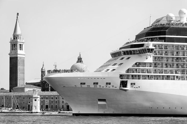 Cruise ship on sea with st mark square against clear sky