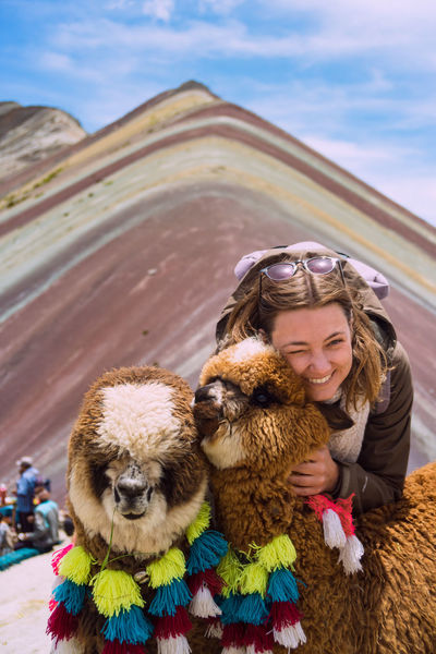 Alpaca Happiness in Peru Moments Of Happiness Mammal Domestic Animals Pets Women Smiling Real People Front View Warm Clothing Rainbow Mountain Altitude Peru Cusco Southamerica Alpaca Alpacas Girl Travel Portrait Tourism Cold Temperature Colorful Fluffy Cute