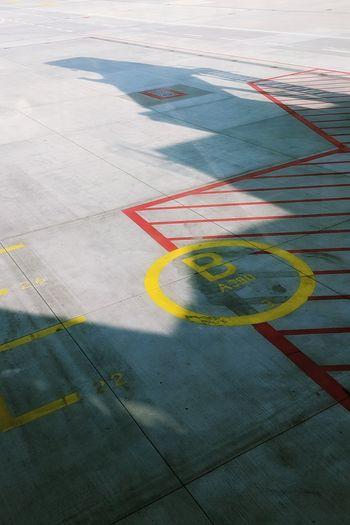 High angle view of markings at airport runway