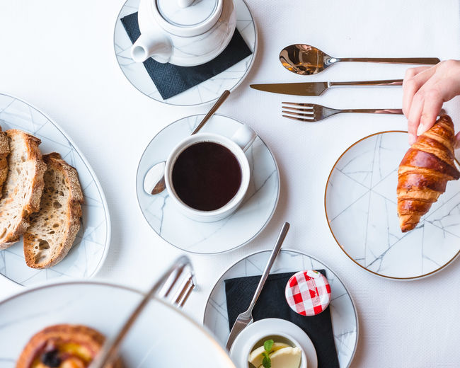 Food And Drink Drink Cup Table Mug Refreshment Coffee Food Coffee - Drink Coffee Cup Plate Human Hand Kitchen Utensil Eating Utensil Hand Saucer Freshness Meal High Angle View One Person Crockery Breakfast Hot Drink French Food Glass Breakfast Brunch