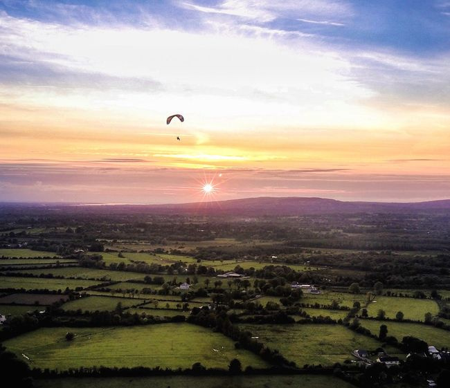 Sunset Beauty In Nature Scenics Landscape Nature Sky Tranquil Scene Sun Field Tranquility Agriculture Adventure Sunlight Outdoors Silhouette Cloud - Sky Rural Scene Tree Travel Destinations No People Paragliding Paraglider Limerick Ireland
