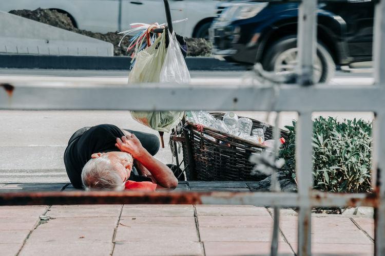 Homeless man sleeps on the street , bangkok thailand.the poor man