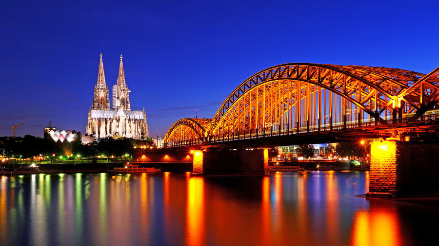 Beautiful night with hohenzollern bridge and cathedral in Cologne, Germany Architecture Built Structure Connection Illuminated Travel Destinations Water Building Exterior Bridge - Man Made Structure Reflection Bridge Night City Sky Dusk Nature Transportation No People River Cityscape Hohenzollern  Hohenzollernbridge Germany Metropolis Twilight Sky Carnival Gothic Architecture Reflection In Water Europe European  European Architecture Rhine River Train Blue