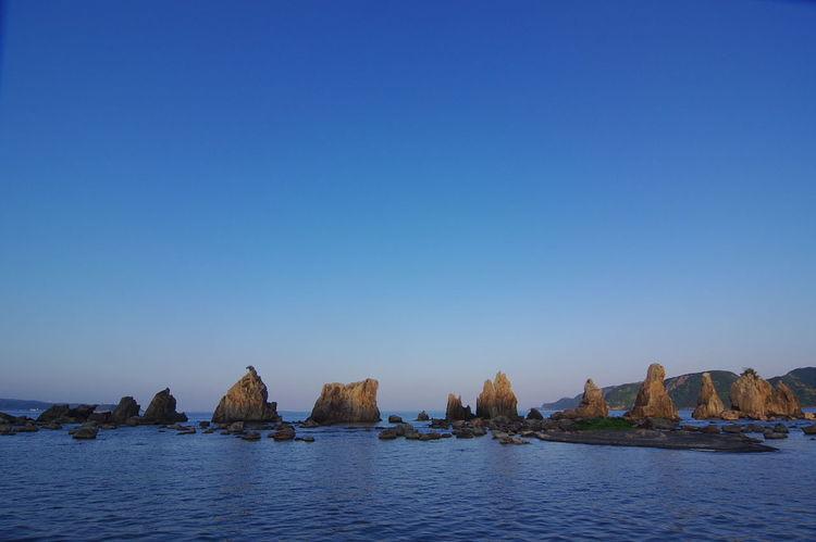 今年のツーリングは、和歌山県串本町の橋杭岩を撮りに行ってきました。 橋杭岩 Landscape Rocks Rocks And Water Clear Sky Blue Sunset