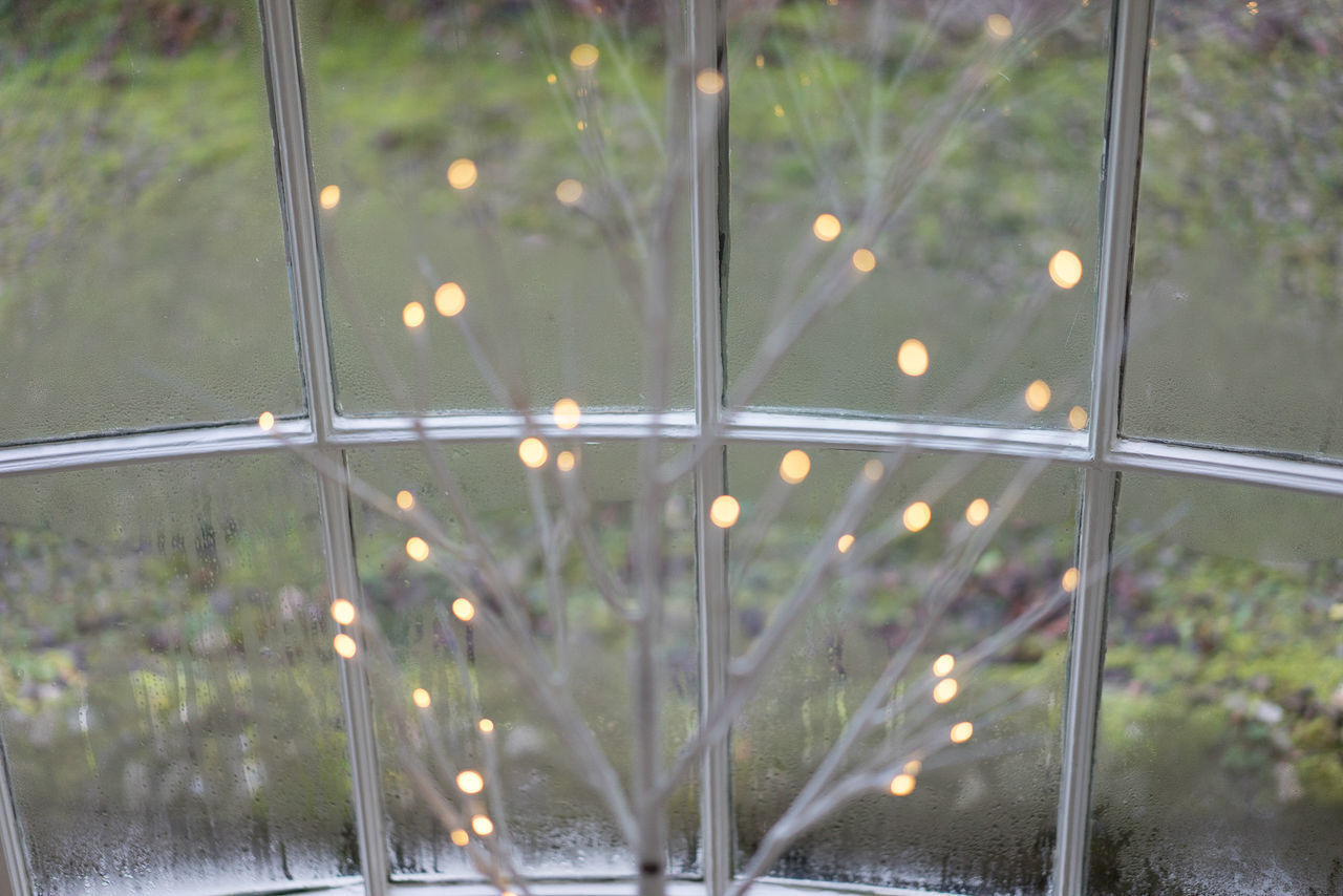 CLOSE-UP OF WET GLASS WINDOW WITH RAIN