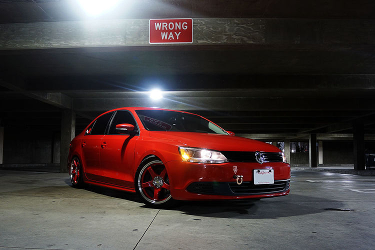 Red vintage car on street at night