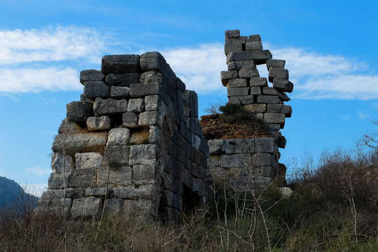 Low angle vie of old ruin against blue sky