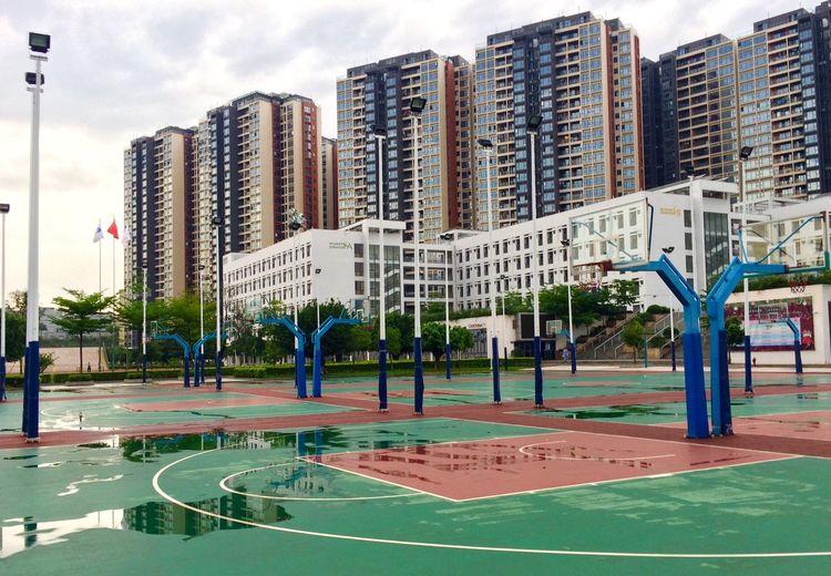 Wet Basketball Court In Front Of School Building