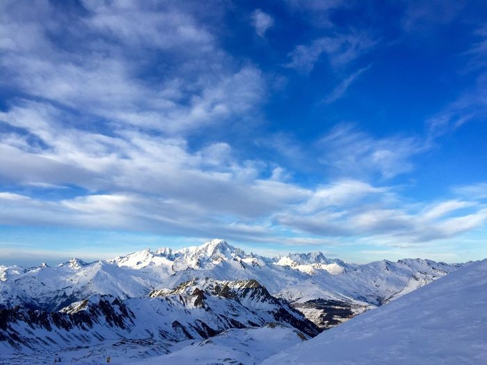 Scenic view of snowcapped mountains against blue sky in france