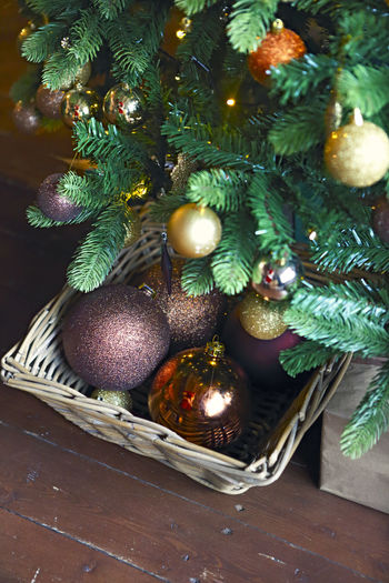 High angle view of christmas tree in basket on table