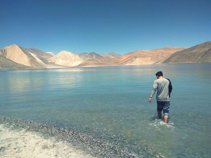 Man walking in shallow water