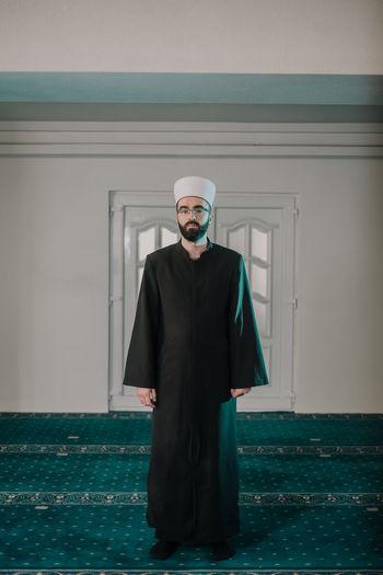 Portrait of man standing in mosque