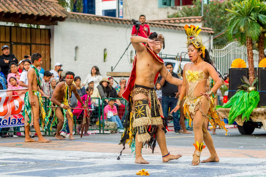 Architecture Building Exterior Built Structure Celebration Dance Day Enjoyment Fun Huaurani Large Group Of People Leisure Activity Lifestyles Men Outdoor Outdoors People Performance Real People Shirtless Street Teenager Tribal Tribe Woman Young Adult