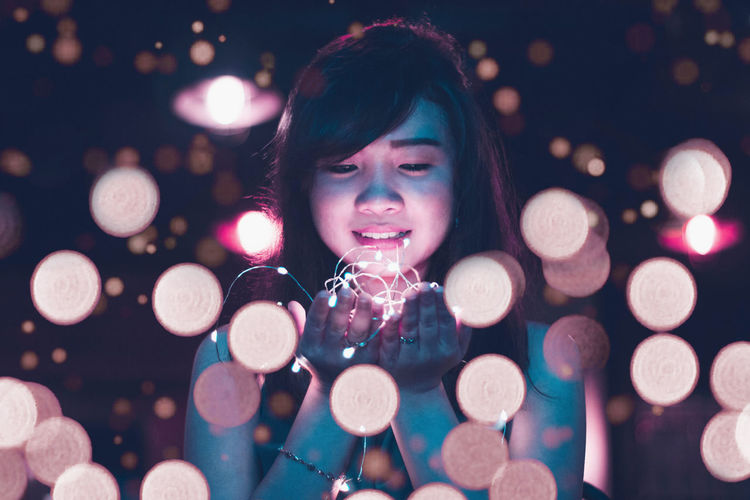Bangs Beautiful Woman Celebration Christmas Christmas Decoration Christmas Lights christmas tree Close-up Defocused Electric Light Happiness Holding Illuminated Indoors  Lifestyles Lighting Equipment Looking At Camera Night One Person People Portrait Real People Smiling Young Adult Young Women