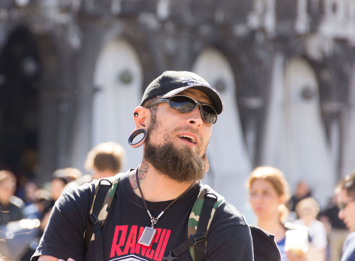 Venice, Italy - September 28, 2015: a man with a big earring looking at the Dogee Palace on San Marco Square, Venice, Italy BIG Casual Clothing Day Dogee Eardrops Earrings Europe Hanger HEAD Italy Lifestyles Link Look Male Man Marco Mid Adult Men Outdoors Palace Portrait Shackle Tourism Travel Venice Watching