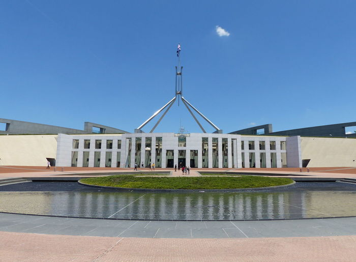 Australia Australian Canberra Parliament Building Architectural Column Architecture Blue Building Building Exterior Built Structure Capital City Clear Sky Copy Space Day Modern Nature No People Outdoors Parlament Parliament Parliament House Reflection Sky Sunlight Travel Travel Destinations Water