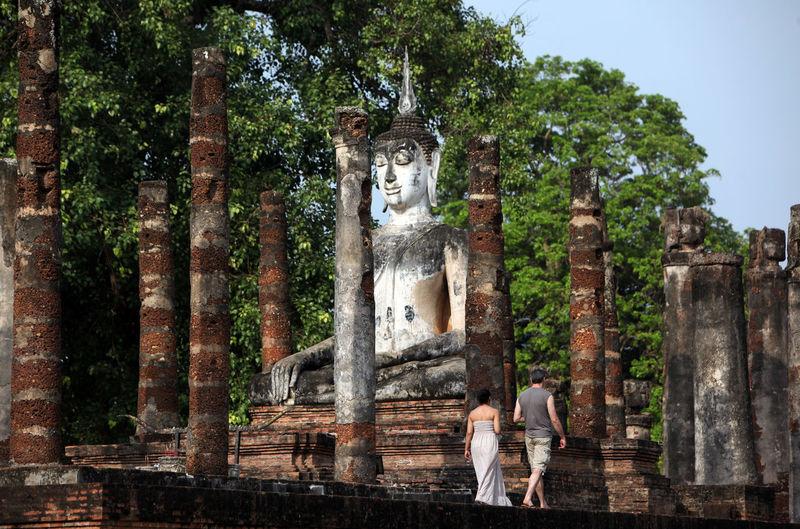 Rear View Of Man And Woman Traveling At Wat Sa Si