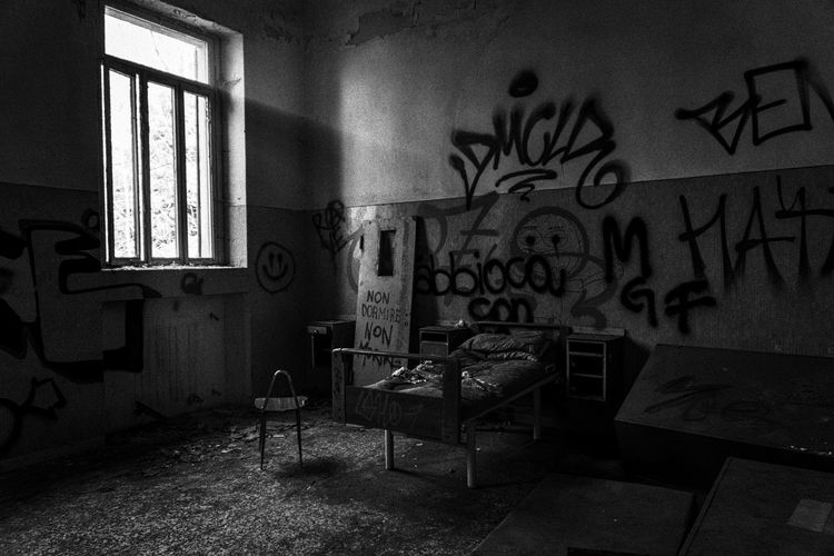 Mental Hospital  Indoors  Graffiti Architecture No People Chair Furniture Seat Window Table Home Interior Absence Built Structure Building Empty Domestic Room Abandoned Day Wall House Rays Of Light The Mobile Photographer - 2019 EyeEm Awards The Minimalist - 2019 EyeEm Awards