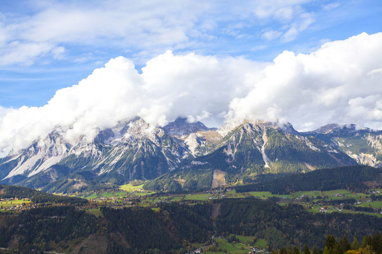 Scenic view of mountains covered with clouds