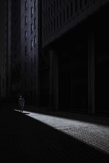 Shadow of man walking on building at night